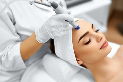 Face Skin Care. Close-up Of Woman Getting Facial Hydro Microdermabrasion Peeling Treatment At Cosmetic Beauty Spa Clinic. Hydra Vacuum Cleaner. Exfoliation, Rejuvenation And Hydratation. Cosmetology.
